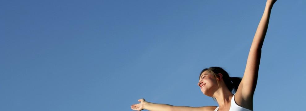 Happy, healthy woman enjoying the beautiful outdoors.