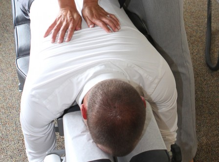 A man getting a gentle adjustment in one of our treatment rooms