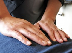 A picture of two hands giving a massage to a patient.
